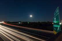 lights from cars passing by on a highway at night