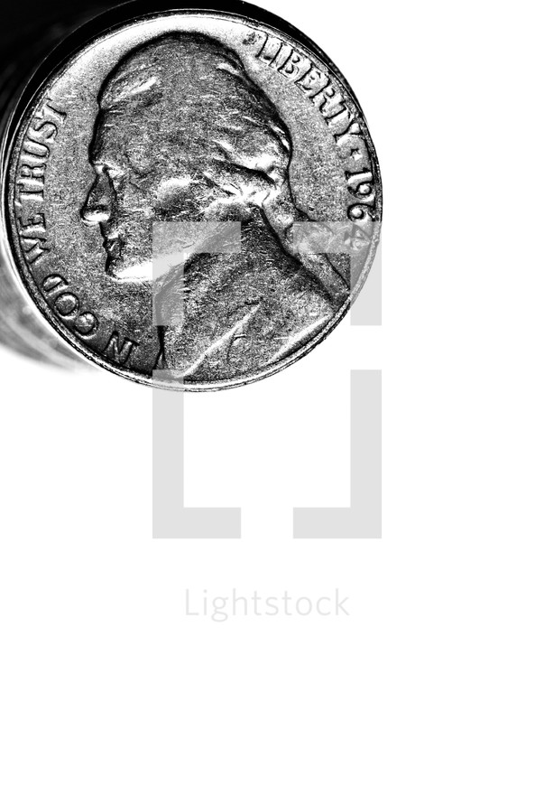 A stack of nickels isolated on white