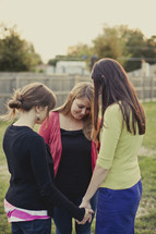 Women praying in circle