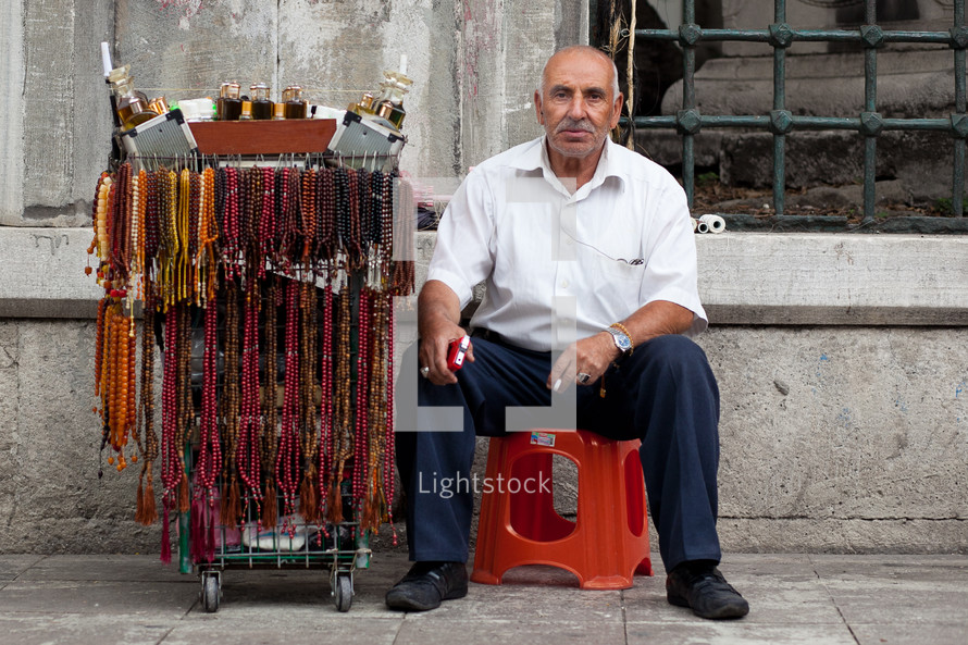 Muslim Turk street vendor selling Islamic prayer beads