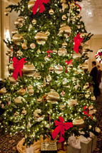 christmas tree with gold ornaments
