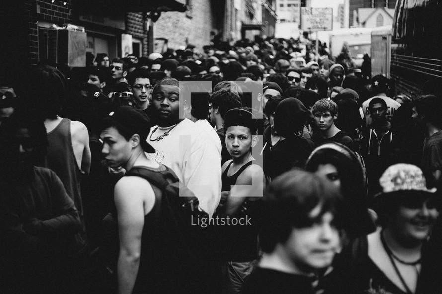 crowds of people on a busy sidewalk