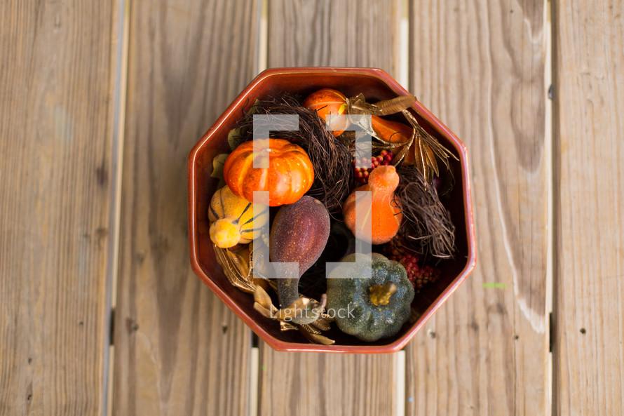 A bowl of pumpkin gourds
