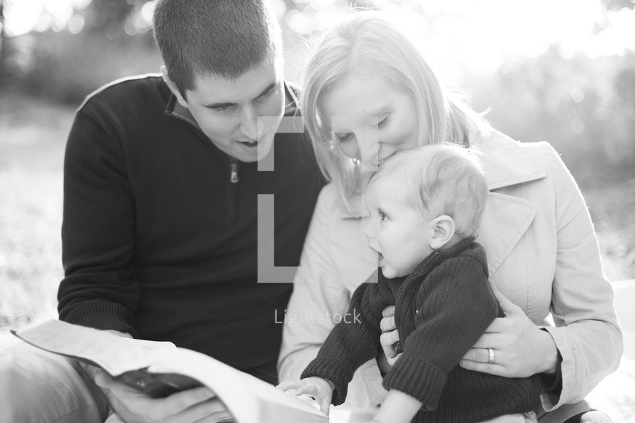 A young family reading the Bible together