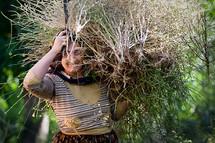 Kurdish woman carrying herbs