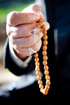 hand holding prayer beads