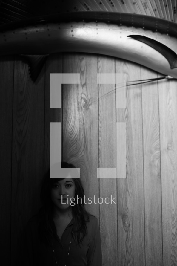 Woman standing in front of wood panels