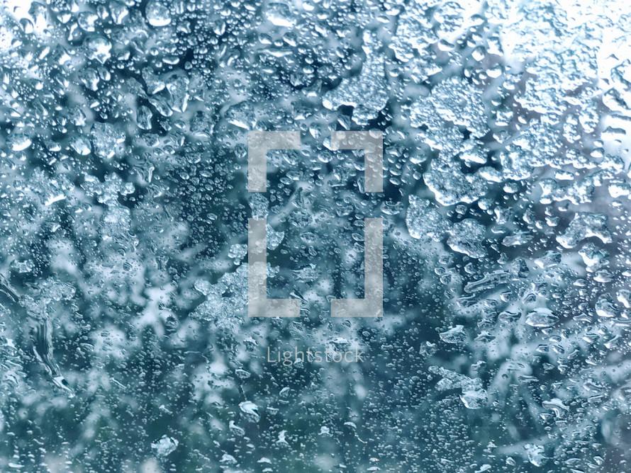 melting snow on glass