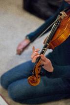 teen girl playing a violin