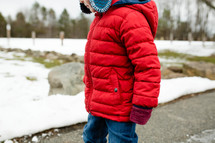 a child in a winter coat
