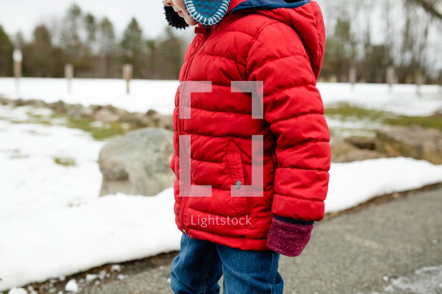 a child in a winter coat