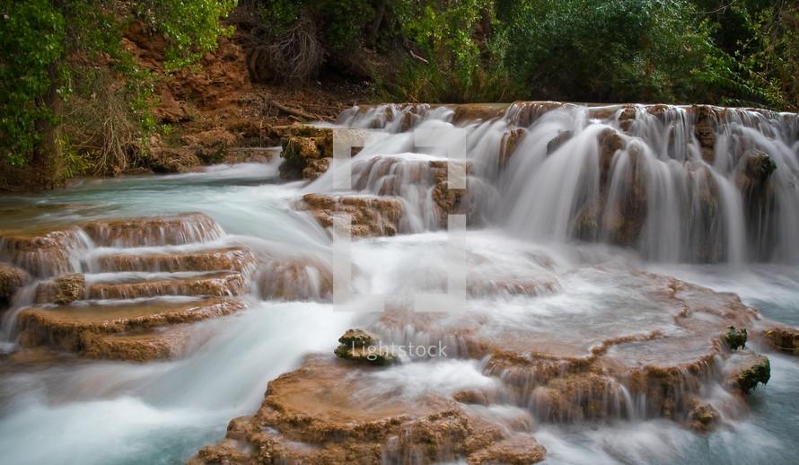 water flowing over rapids