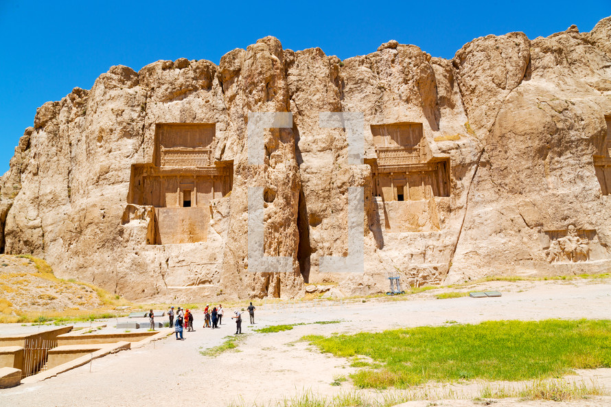 buildings carved into cliffs in Iran