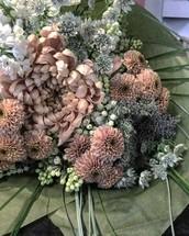 a bouquet of blush flowers