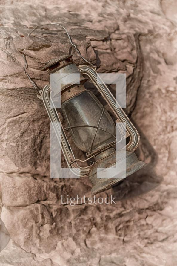 antique lantern on rock