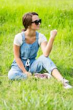 teen girl picking flowers in a field