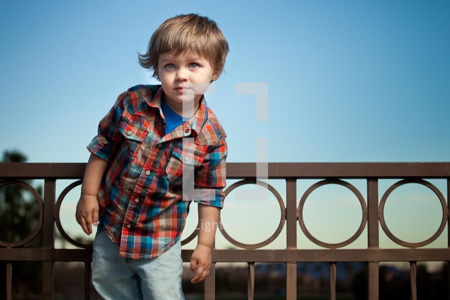 toddler boy on a balcony