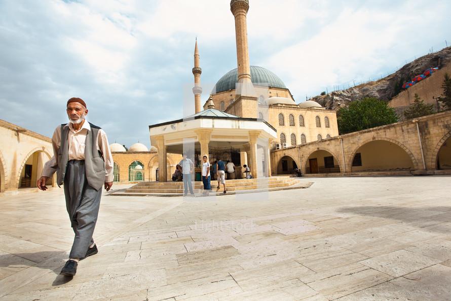 Men leaving mosque