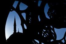 Rustem Pasha Mosque seen through silhouette of modern art sculpture