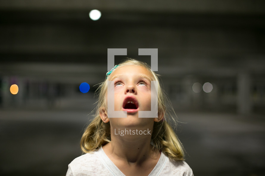 amazed little girl with her mouth open