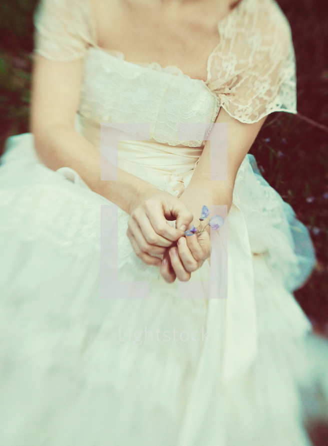 Bride holding purple flower
