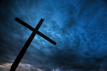 Cross against dark stormy sky