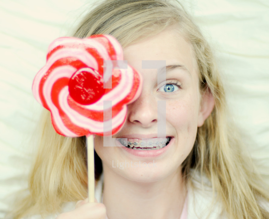Teenager holding lollypop