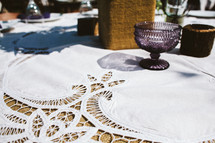 lace table cloth and set table for an outdoor wedding