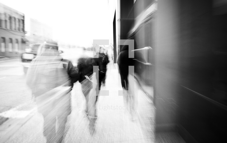 blur of passing pedestrians