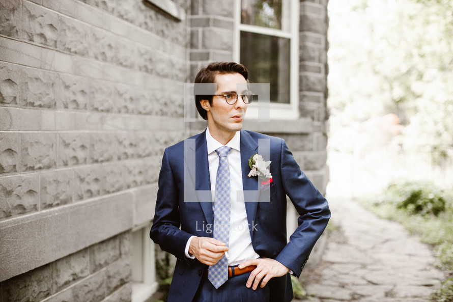 groom smoking a cigarette