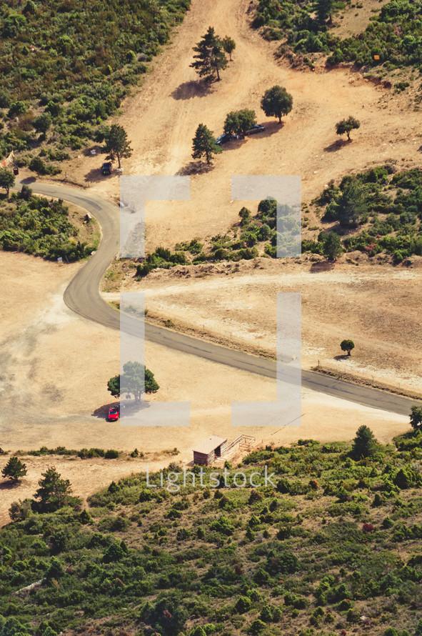 aerial view over plowed land below