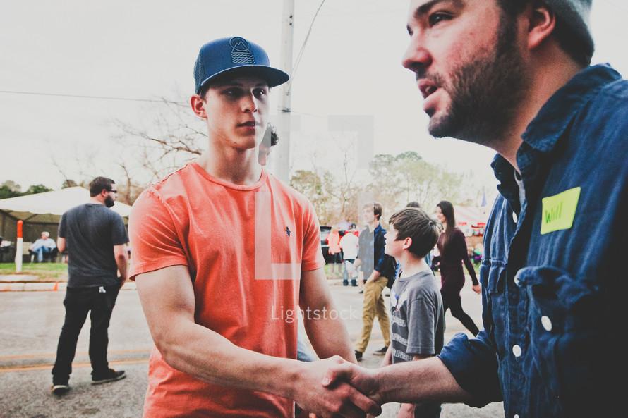 greeting before a church service, hand shake