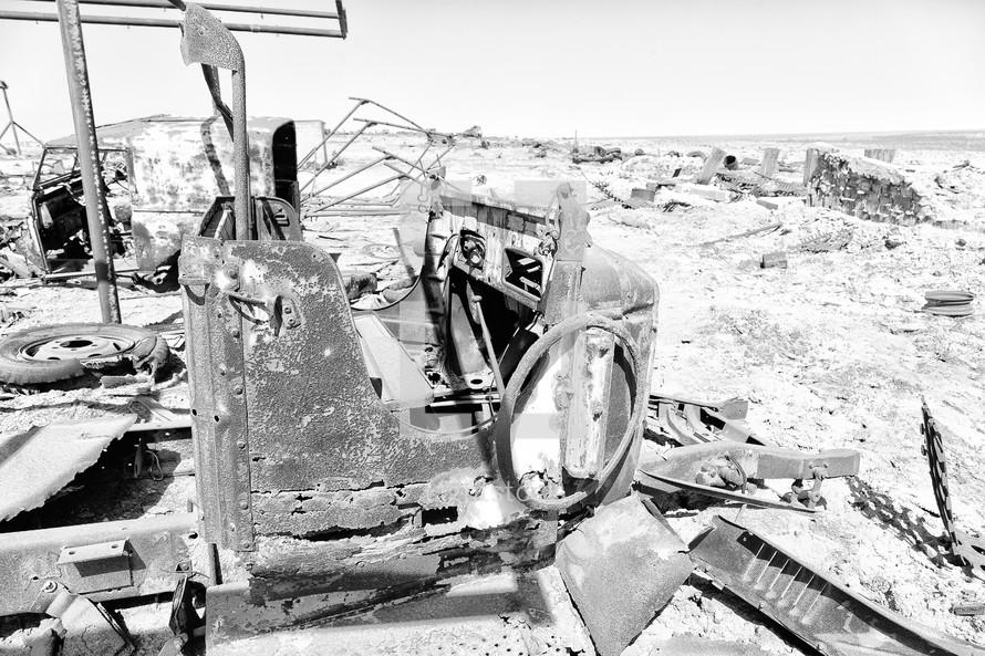 old rusty antique car in a desert