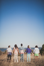 holding hands, fellowship, walking, woman, people, outdoors, group, field, sunlight, team