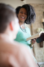 a woman leading a discussion at a Bible study