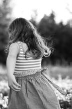 Little girl running in flower field