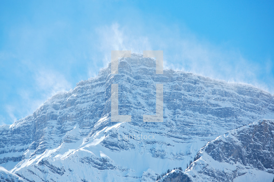 snow spindrift on mountain peak