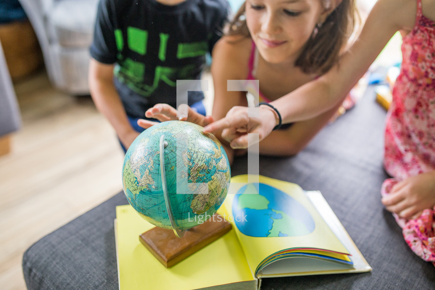 children playing with a globe
