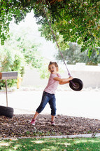 a toddler girl with a tire swing