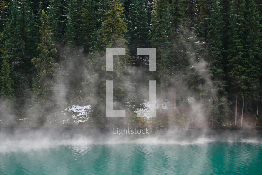 rising mist from alpine lake