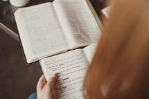 reading a Bible and writing in a journal during a Bible study