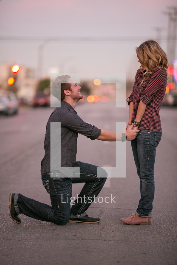 Man proposing on one knees