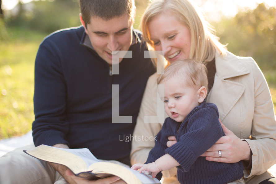family of three reading bible