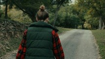 teen girl walking down a rural road