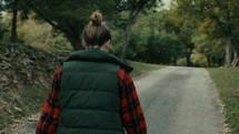 teen girl walking down a rural road