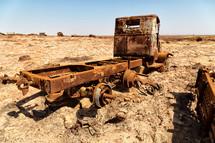 old rusty metal truck in a hot desert