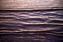 ripples in ocean water along a shore