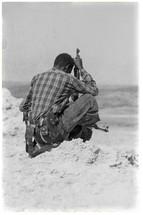 soldier in Africa holding a gun