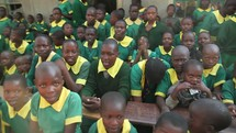 school children singing and clapping