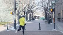 man running in a city